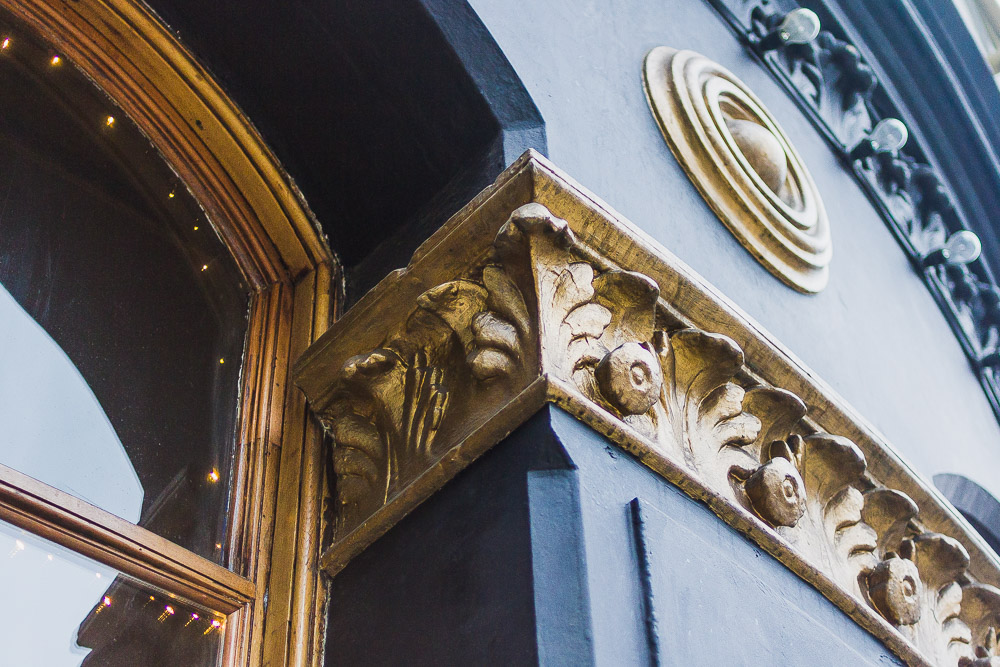 the old blue last pub london gold detail window