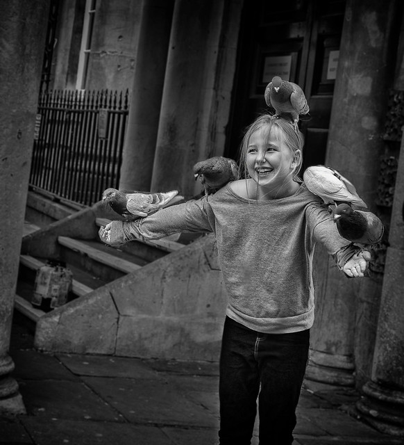 smiling girl with pigeons