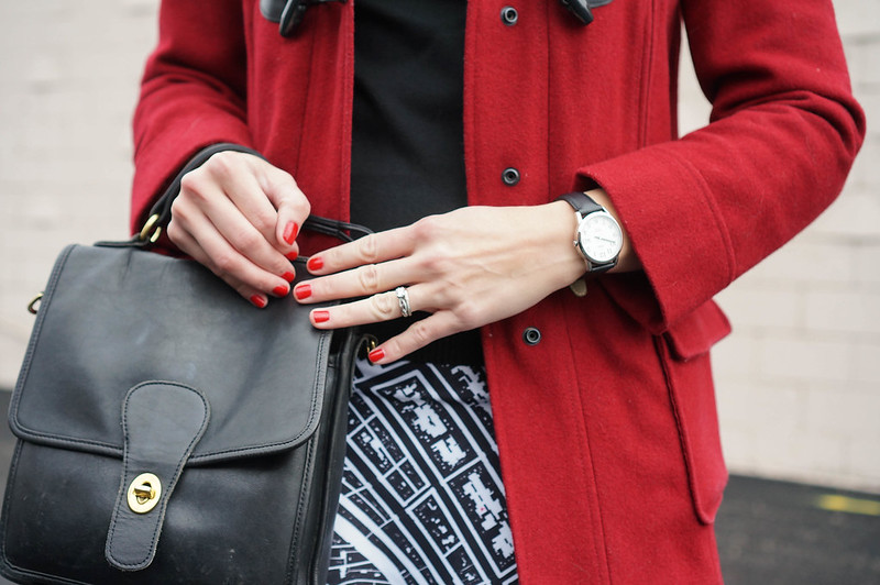 red toggle coat, map print skirt, black turtleneck; winter style; Style On Target
