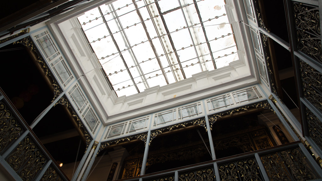 Glass ceiling allowing natural sunlight into the mansion