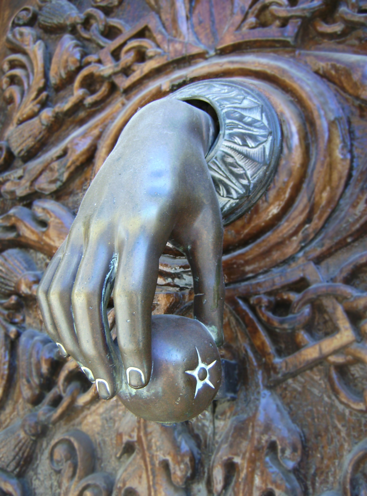 Hand door knocker, Trujillo, Spain. Credit Julius Eugen