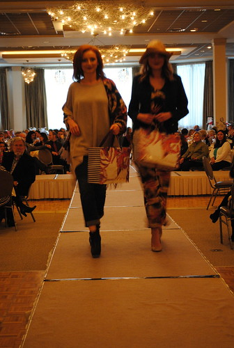 KYC Fashion Show photo of 2 models on the runway