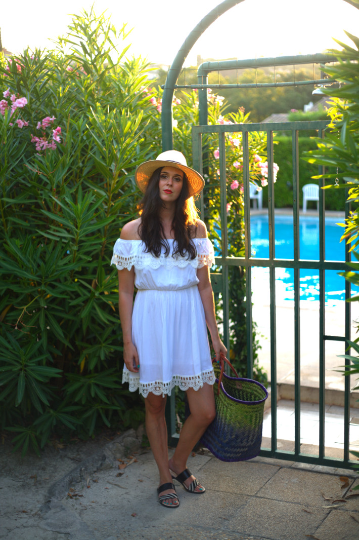 outfit: white off shoulder dress with embroidered hem and havana hat