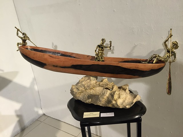 boat with 3 brass figurines