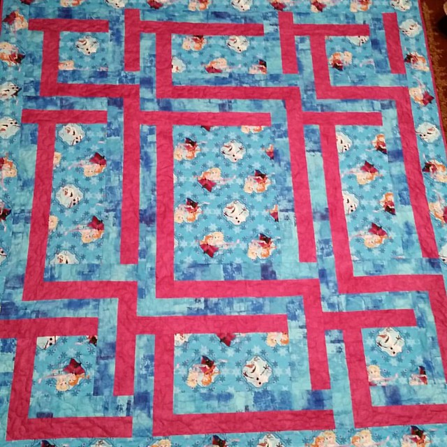 Mikaela's Frozen quilt is bound and on her bed. She'll be excited when she wakes up tomorrow morning.