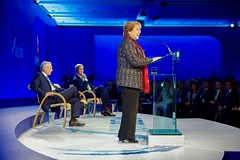 U.S. Secretary of State John Kerry and Chilean Foreign Minister Heraldo Muñoz listen as Chilean President Michelle Bachelet addresses the 2015 Our Ocean conference in Valparaiso, Chile, on October 5, 2015. [State Department photo/ Public Domain]