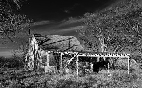 winter sky blackandwhite monochrome grass clouds shadows horizon wires abandonedhouse infrared weathered baretrees antenna boardedupwindows fadedpaint exposedwood cloudsstormssunsetssunrises