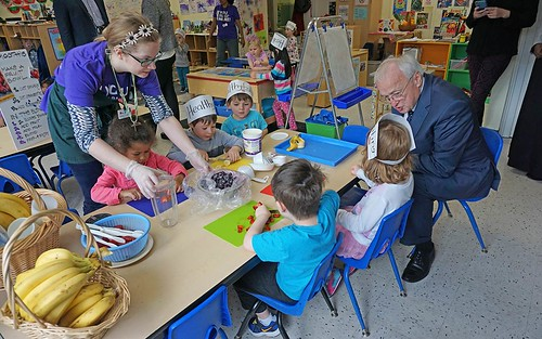 USDA Undersecretary of Food, Nutrition, and Consumer Services Kevin Concannon participating in a hands-on lesson about local foods at a YMCA preschool in West Seattle, WA