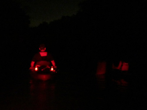 Two kayaks, at night.