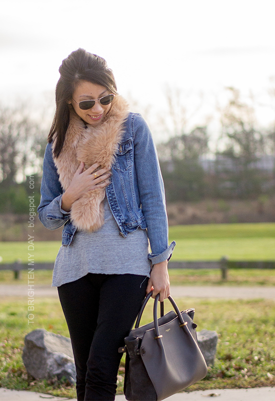 faux fur scarf, denim jacket, gray tee, black pants, gray tote