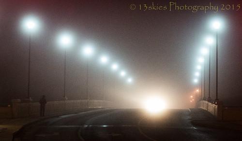 road morning bridge mist cold car fog night walking alone darkness streetlights foggy headlights distance approaching lampposts