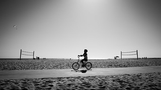 A boy cycling in Venice Beach - Los Angeles, United States - Black and white street photography