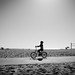 A boy cycling in Venice Beach - Los Angeles, United States - Black and white street photography by Giuseppe Milo (www.pixael.com)