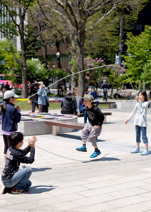 School kids skipping at Odori Park in Sapporo