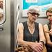 New York City Street Scenes - Two Women Talking on a Subway Train by Steven Pisano