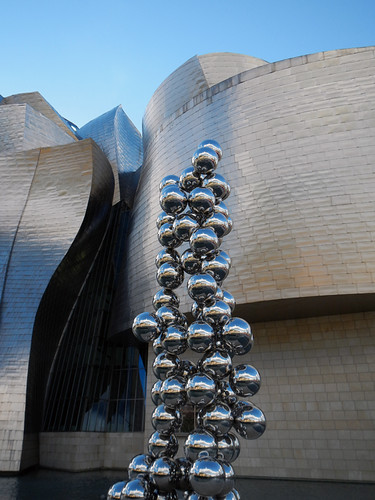 The Frank Gehry designed Guggenheim in Bilbao with a sculpture of shiny bubbles in front