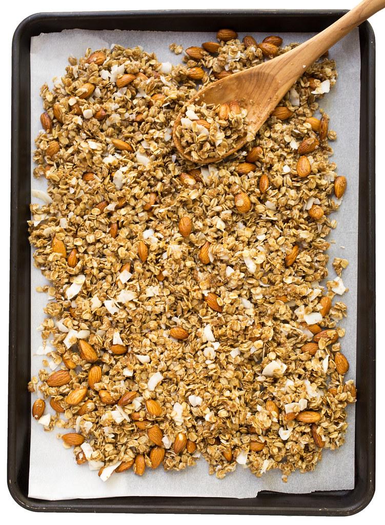 cherry almond granola spread onto pan