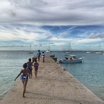 Swimming lessons the local way. 1-2-3-4, back in the water for a little more. The pier at Grand Case, St. Martin. This is the Caribbean.