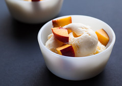 Two vanilla ice-cream with peach, selective focus