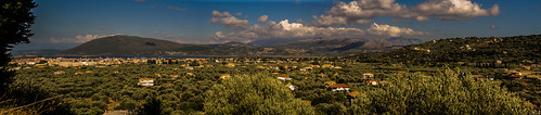 city blue sea panorama mountains green clouds 35mm island prime nikon outdoor sunny greece bluewaters ioniansea olivetrees lefkas lefkada d3100 ayamavra