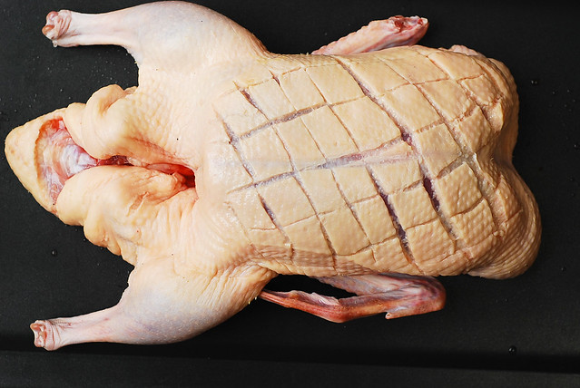 score the duck skin in a diamond patter, roast duck recipe, duck cooking