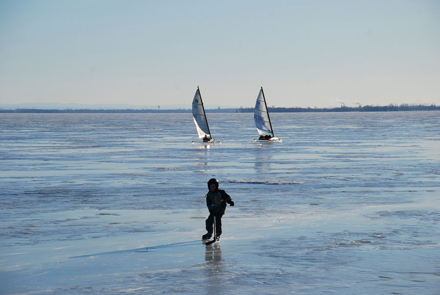 Hockey Player and Sailskaters at Pointe-Claire at Windy Winter Day, ebruary 14, 2009 Red Pilot