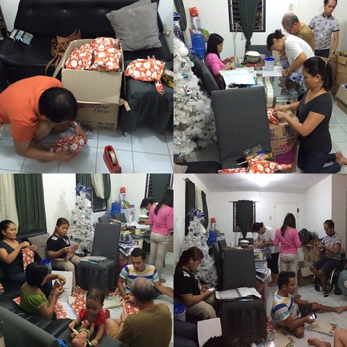 Volunteers of Behind the Rolling Chair wrapping gifts for the kids