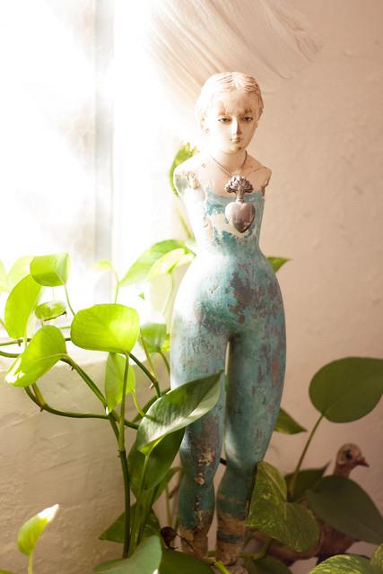 Wide-hipped fertility figure of a woman in aquamarine