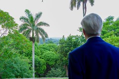 U.S. Secretary of State John Kerry looks at Havana, Cuba, from a favorite spot on the veranda at Finca Vigia - author Ernest Hemingway's former home in San Francisco de Paula, Cuba - during a tour on August 14, 2015. [State Department photo/ Public Domain]