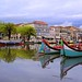 The colourful Moliceiros at the serene waters of Aveiro by B℮n