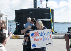 USS Key West Engineer Officer Lt. Cmdr. Judson Thomas is surprised with a gender reveal by his wife and son during the submarine's homecoming. (U.S. Navy/Lt. Lauren Spaziano)