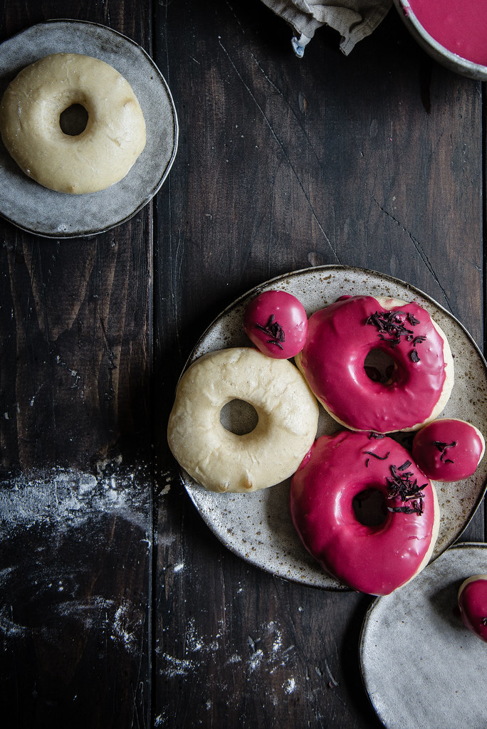 baked yeast doughnuts with hibiscus glaze | two red bowls