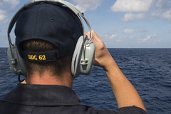 Seaman James Harback uses binoculars to observe the People's Liberation Army (Navy) Jiangkai II-class frigate Yuncheng (FFG 571) from USS Fitzgerald (DDG 62) as it conducts a routine transit through the South China Sea, Nov. 12. (U.S. Navy/MC2 Patrick Dionne)