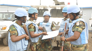 Kinshasa, DR Congo: Female soldiers of the Ghanaian battalion accessing map before patrol in Kinshasa.