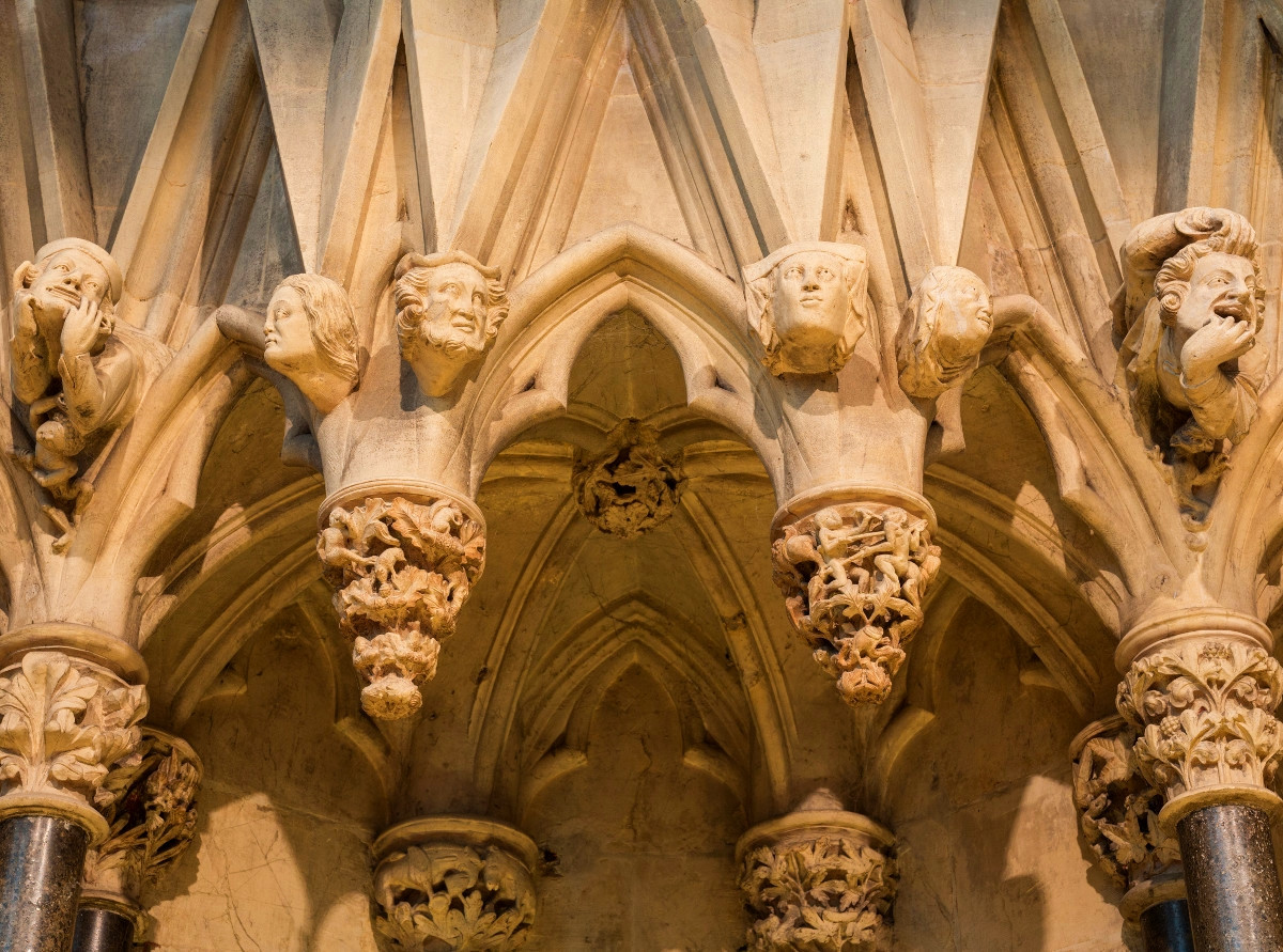 Grotesques on the wall of the chapter house in York Minster. Credit David Iliff