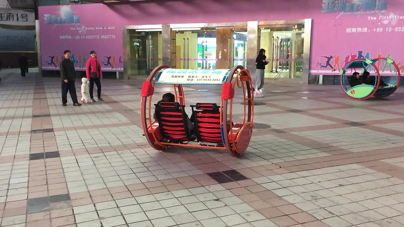 Hamster wheel cart in action near Sun Dong An Plaza.