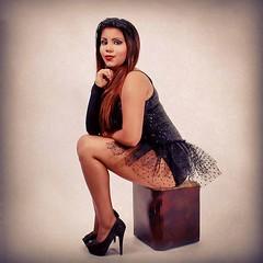 black hair(1.0), hairstyle(1.0), model(1.0), art model(1.0), limb(1.0), leg(1.0), fashion(1.0), photo shoot(1.0), lady(1.0), long hair(1.0), human body(1.0), thigh(1.0), person(1.0), beauty(1.0), sitting(1.0),