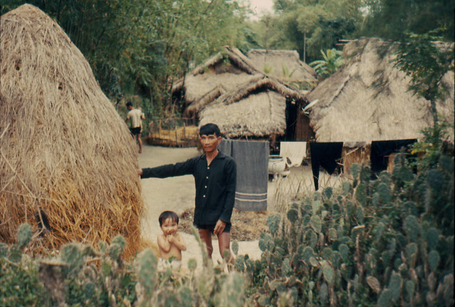 Vietnam 1966 - Huts and locals
