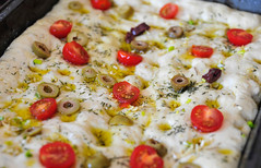 Focaccia with Olives, Garlic and Rosemary. Resting…
