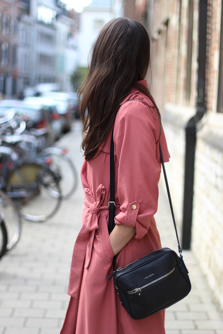 outfit: pink trenchcoat and printed trousers