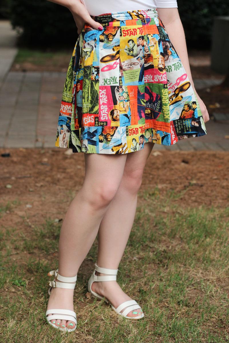 Star Trek Print Pleated Mini Skirt with White Sandals