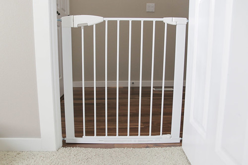 Munchkin white baby gate in doorway