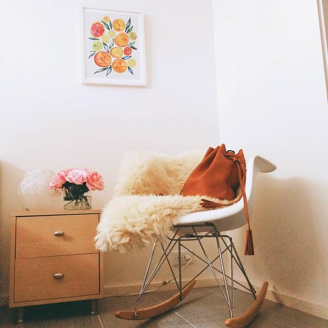 cute & little blog | art crate curated art print, modern plastic rocker, sheepskin, tan bucket bag