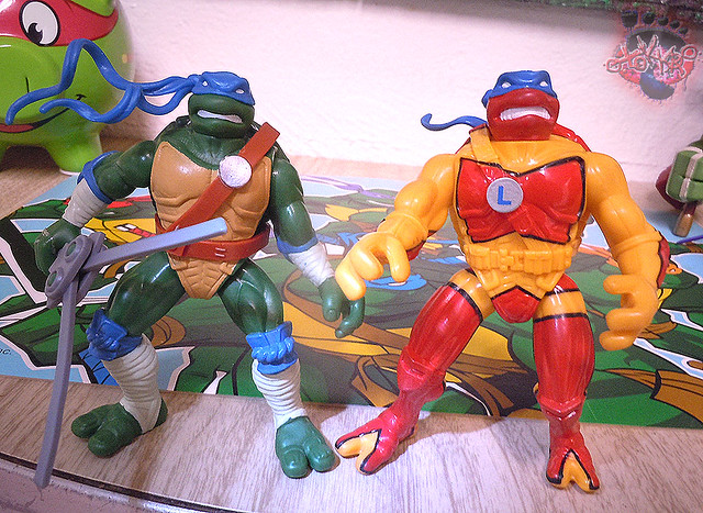 "Nickelodeon ""HISTORY OF TEENAGE MUTANT NINJA TURTLES"" FEATURING LEONARDO - 'NINJA TURTLES: THE NEXT MUTATION' LEONARDO vii / ..with N.M. TURTLEFLAGE Camo Blitz Cycle '98 (( 2015 ))"