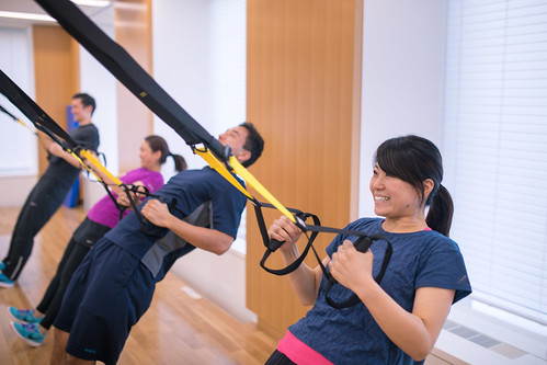 Young athletes training with TRX