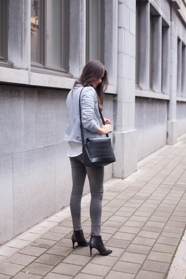 outfit: grey biker jacket, grey skinnies and pointy toe stiletto boots