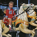 Small photo of Boy on a merry-go-round in Taos, New Mexico