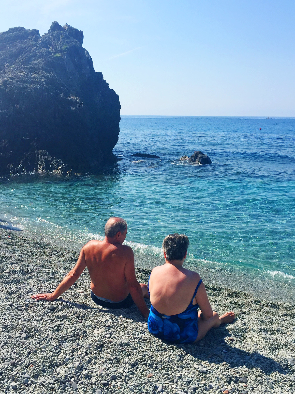 Monterosso Cinque Terre old couple sitting on beach