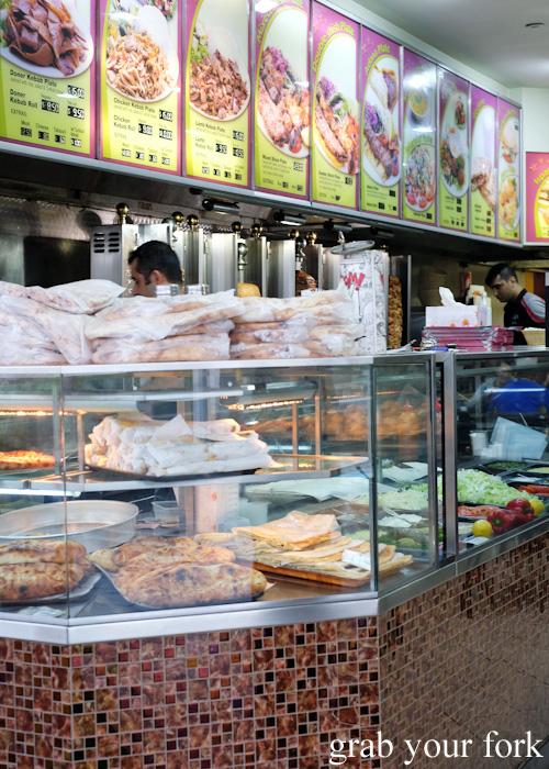 Pide, Turkish bread, gozleme and salads below the menu board at New Star Kebabs, Auburn