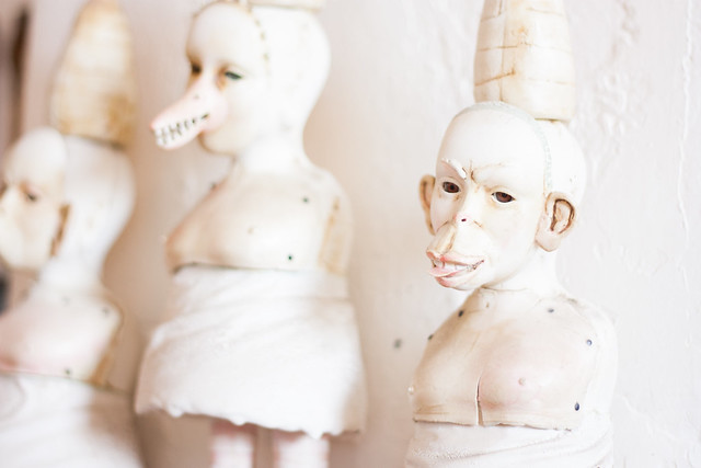Faces of Judy Kendall's daughter-in-law's humanoid figures